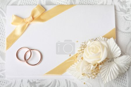 Photo for Wedding invitation card with gold rings and satin rose - Royalty Free Image