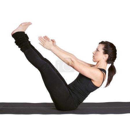 Yoga excercising navasana