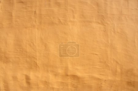 Close up shot of vintage yellow wall as background...