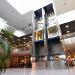 Modern interior of trade center with lifts...