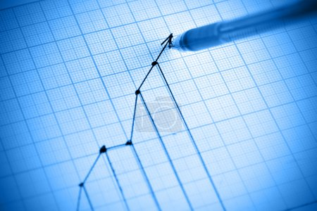 Pen drawing profit line graph