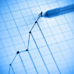 Pen drawing profit line graph. Shallow DOF!...