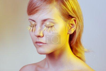 Woman wearing petal eyelashes