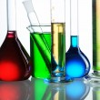 Chemical flasks with reagents isolated on white ba...