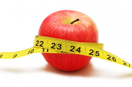 Photo for Red apple and measuring tape isolated on white - Royalty Free Image