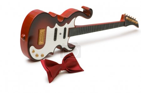 Guitar and bow tie isolated on the white