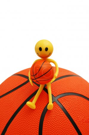 Smilie sitting on basketball isolated on white