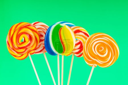 Photo for Colourful lollipop against the colourful background - Royalty Free Image