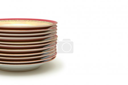 Stacked plates isolated on white - space for your text