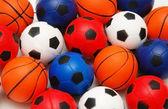 Selection of basketballs and footballs
