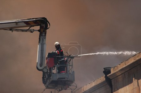 Firefighter on a boom during fire