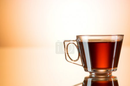 Photo for Cup of tea on the reflective surface - Royalty Free Image
