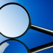 Magnifying glass with wooden handle on the flat su...