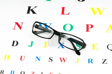 Photo for Optical reading glasses on the eyesight table - Royalty Free Image