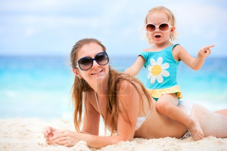 Mother and daughter on beach vacation
