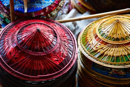 Photo for Traditional asian straw hats at floating market in Thailand - Royalty Free Image