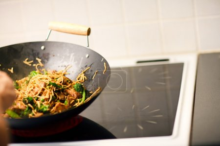 Photo for Chef cooking vegetablesand noodles in wok pan - Royalty Free Image