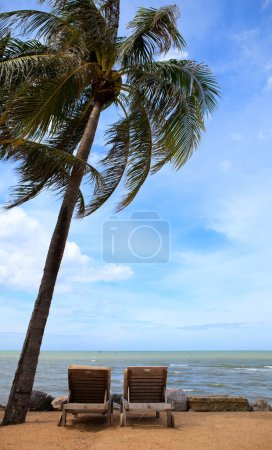 Photo for Tropical Paradise. Two sun beds on exotic beach. - Royalty Free Image