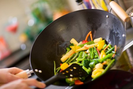 Photo for Chef cooking vegetables in wok pan - Royalty Free Image