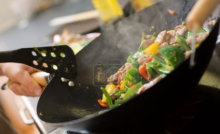 Photo for Chef cooking vegetables and meat in wok pan - Royalty Free Image