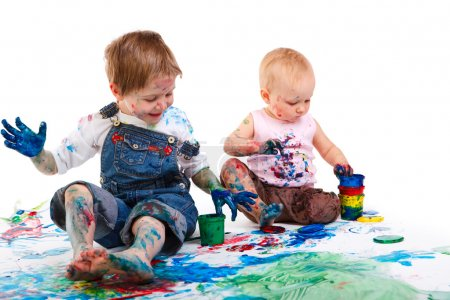 Photo for Cute 5 years old boy and toddler girl painting on white background - Royalty Free Image