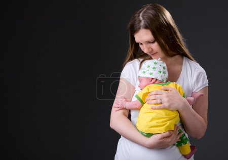 Happy young mother and newborn girl