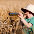 Portrait of young nature explorer in wheat field...