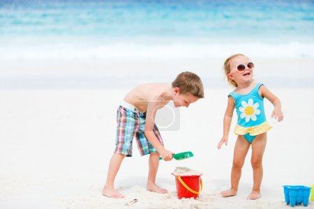 Kids playing with beach toys