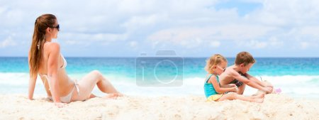 Mother and two kids at tropical beach