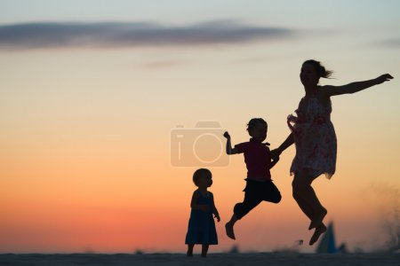 Family fun at sunset beach