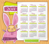 Vector calendar 2011 with pretty rabbit and paper framework bunny is symbol of 2011 year starts sunday