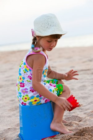 Photo for Series: little girl play the game on the beach - Royalty Free Image