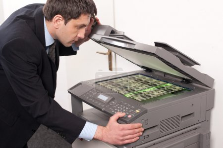 Businessman make false money on copy machine