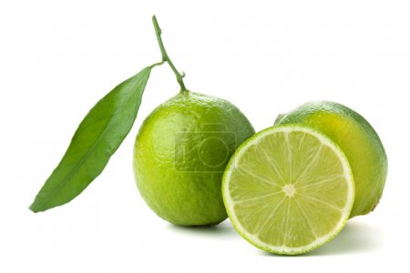 Fresh limes with green leaf