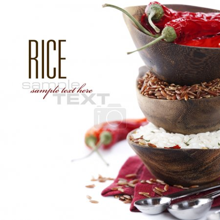 Photo for Bowls of uncooked rice over white with sample text - Royalty Free Image