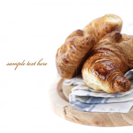 Photo for Fresh croissants over white (easy removable text) - Royalty Free Image