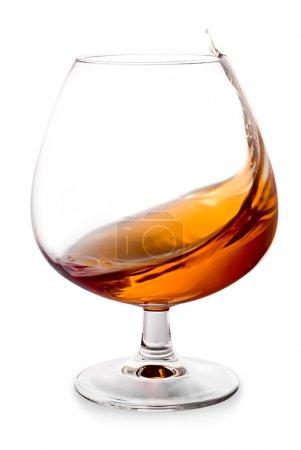 Cognac splashes in a glass