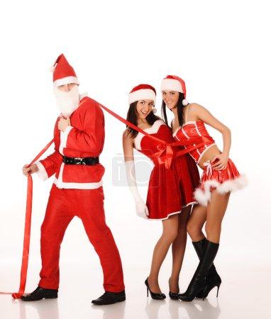 Santa Claus pull two girls