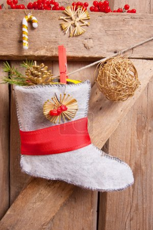 Christmas stocking hanging on wooden background