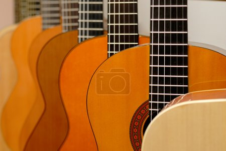 Photo for Row of classical guitars in musical store. Close-up view. - Royalty Free Image