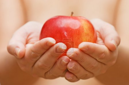 Apple in female hands