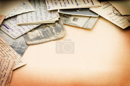 Old letters and photos as a background
