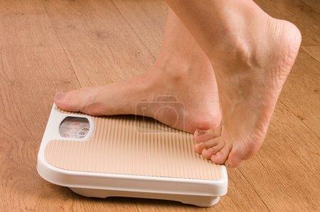 Female feet on scales