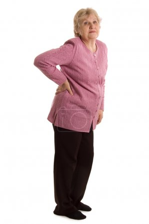 The elderly woman with a pain in a back