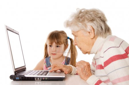 The grandmother with the grand daughter at the computer