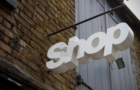 White coloured shop sign