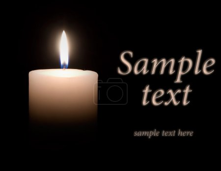 Photo for White wax candle is lit in the dark - Royalty Free Image