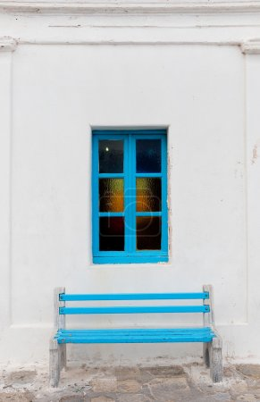 The blue window with colored glass and marble Wood...