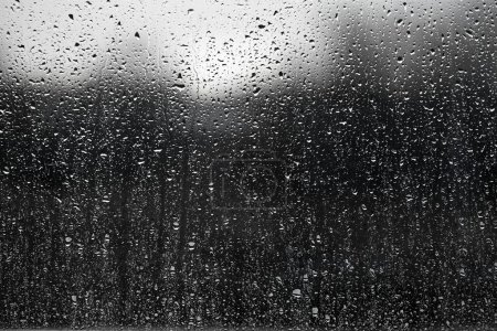 Photo for Raindrops on a window surface - Royalty Free Image
