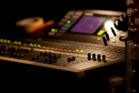 Photo for Soundboard mixer at a concert, shallow focus - Royalty Free Image